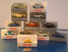 "Wiking came out with a bunch of these ""HO"" scale NBs in various colours and logos.  An even smaller one was issued for the German Post Office.  A German police car is also shown."