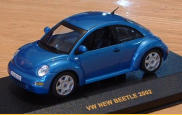 IXO 1:43 Techno Blue, 2003.  Has shorter antenna than others, pattern on the seats, and no bud vase.