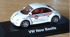 I made this from a regular 1:43 Schuco toy into a Toronto Police Car (Safety Bug)... still have to install a light bar.